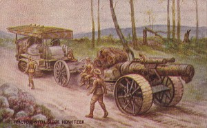 Tractor de oruga de Holt tirando de un Howitzer.
